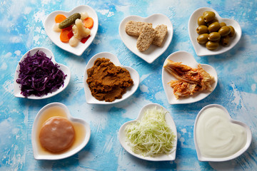 An assortment of fermented foods in dishes