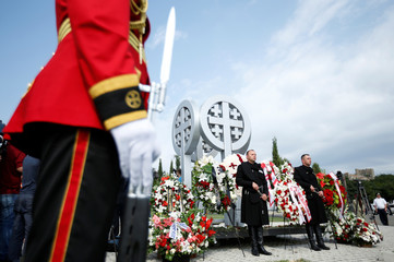 Honor Guard stands at attention during a wreath laying ceremony on the 10th anniversary of Georgian-Russian war at the memorial cemetery of the Georgian soldiers killed during the war in Tbilisi