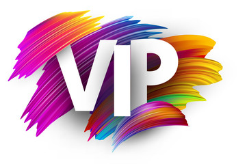 White vip sign with colorful brush strokes.