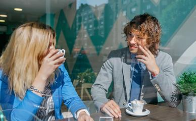 Coworkers flirting on coffee break in cafeteria