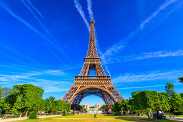 Paris Eiffel Tower and Champ de Mars in Paris, France. Eiffel Tower is one of the most iconic landmarks in Paris. The Champ de Mars is a large public park in Paris
