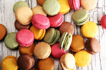 Wall Mural - Sweet and colourful french macaroons or macaron on white backgro