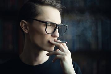 guy smokes cigarette