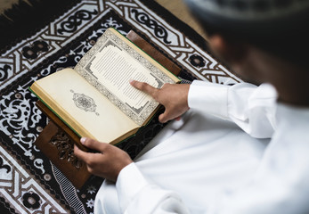 Muslim man studying The Quran