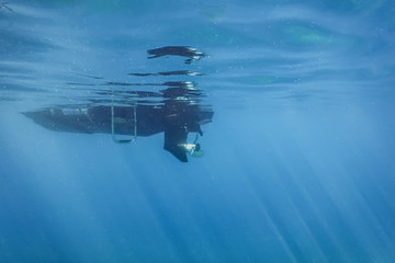Engine motor boat propeller underwater sea surface