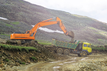 heavy machinery two bulldozers on the construction of roads in the mountains