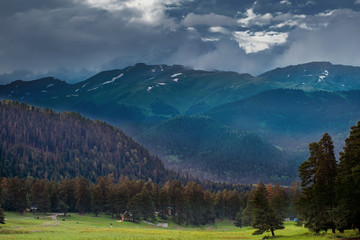 storm clouds over the mountain tops, over the valley