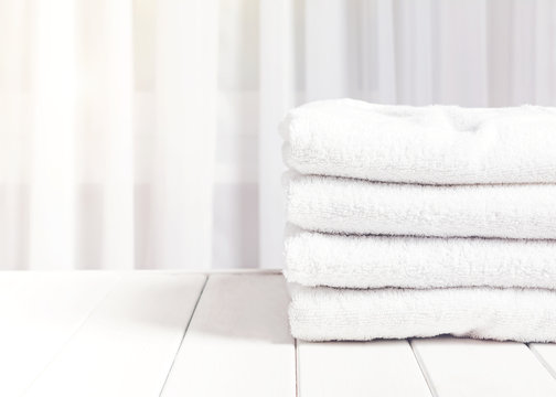 Clean white towels in stack