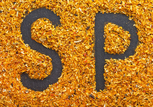 The letters SP are written on the scattered spice