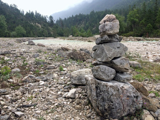 Fleeting art with rocks along the river Isar in the Alps
