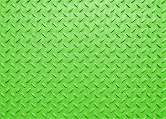 green painted industrial steel sheeting with grid textured flooring pattern
