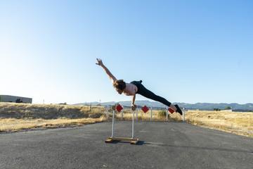 Acrobat balancing on handstand canes