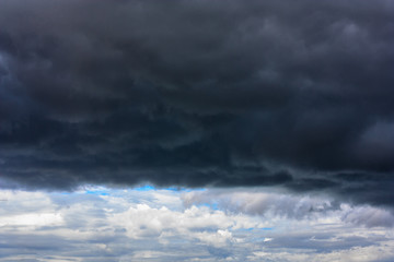 Stormy clouds moving in the blue sky background for rainy season and nature concept
