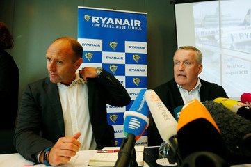 Jacobs, Chief Marketing Officer of Ryanair and Chief Operating Officer Peter Bellew address the media during a news conference in Frankfurt
