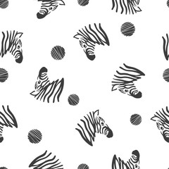 Black and white seamless pattern with zebra heads.