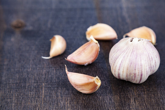 Garlic in a dark background.