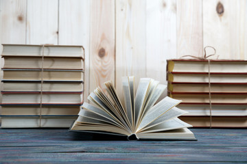group of colorful books on the wooden table