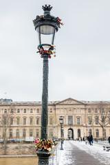 Street lamp with love locks at Pont des Arts