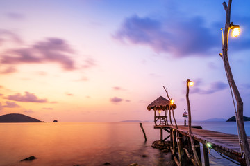 scenic of landscape sunset on sea and wood ocean dock