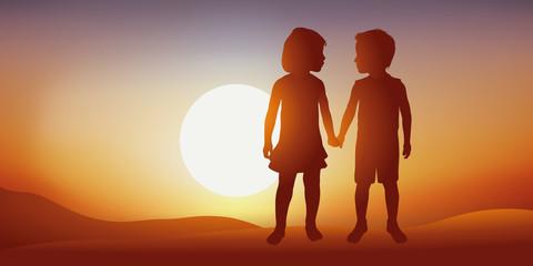 enfants - amitié - ami - amoureux - donner la main - fille - garçon - concept - deux - heureux - bonheur