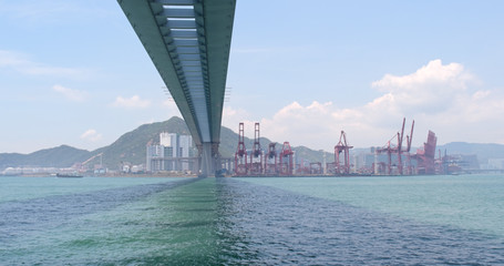 Cargo ship passing the harbor and Kwai Tsing Container Terminal in Hong Kong