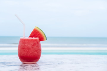 Watermelon smoothie on tropical beach.