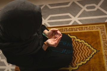 Muslim woman praying salah