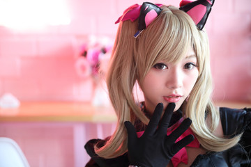 Portrait of Japan anime cosplay girl in pink tone