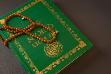 Prayer beads kept on holy Quran