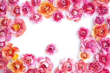 frame of colorful paper pink flowers, roses on white background