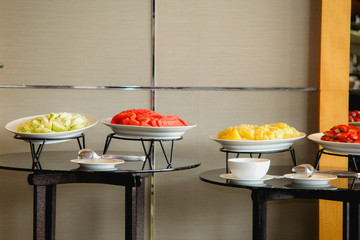 Fruits and desserts put on the table for the customer to eat