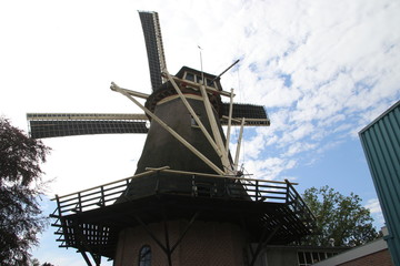 Old dutch windmill in village named Oldebroek with name De Hoop, still working as peel and as grind mill