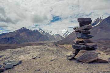 Pile stacked of zen stones or rocks on beautiful Landscape of Padum valley in Karsha village at Zanskar, Ladakh, India.