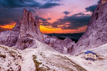 Torri Vajolet at sunset in Rosengarten Catinaccio massif. Beautiful view in Dolomites mountains, Alto Adige, South Tyrol, Italy