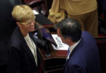 Senator Silvina Garcia Larraburu and Senator Esteban Bullrich talk as lawmakers meet to debate and vote on a bill that would legalize abortion, in Buenos Aires
