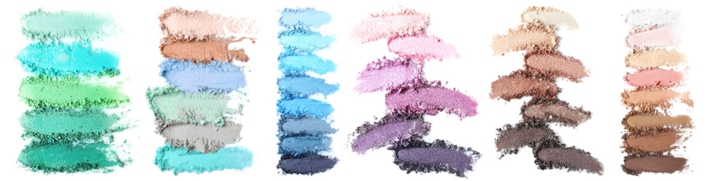 Crushed makeup products on white background. Color set of eye shadows
