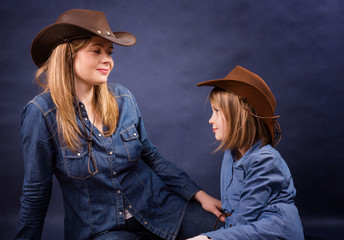 Mother and daughter in cowboys hats