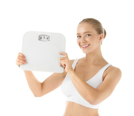 Beautiful young woman with scales on white background. Healthy diet