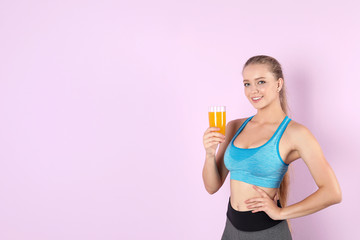 Young woman with glass of juice on color background. Healthy diet