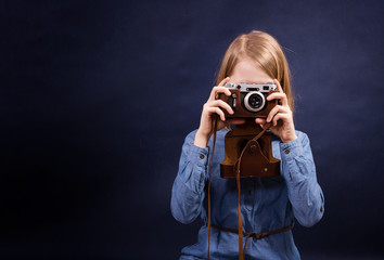 Teenager girl with retro photo camera