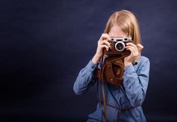 Teenager girl with retro photo camera