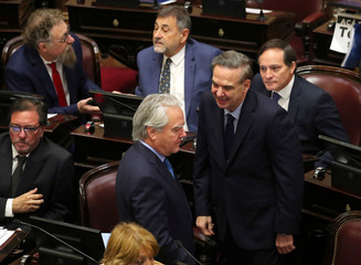 Senator Federico Pinedo and Senator Miguel Angel Pichetto talk as lawmakers meet to debate and vote on a bill that would legalize abortion, in Buenos Aires
