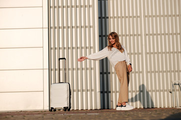girl with a suitcase goes on tour