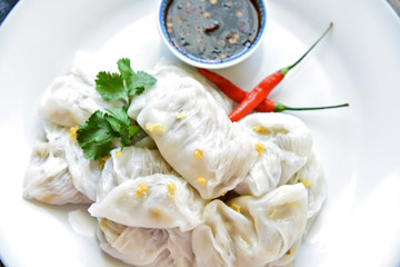steamed rice-skin dumplings with bamboo and pork Filling and black chili