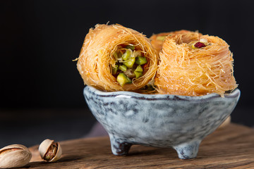 Traditional arabic dessert baklava with pistachios. Dark background