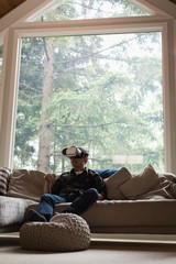 Man using virtual reality headset in living room