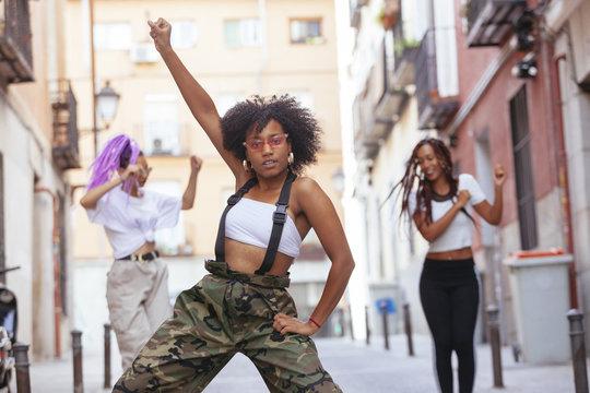 group of ethnic women dancing in the street