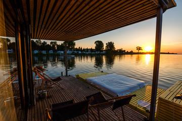 floating cottage on the lake at sunrise