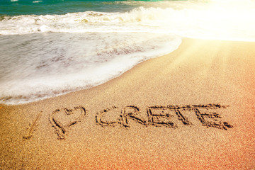 Crete inscription on the sand near the sea
