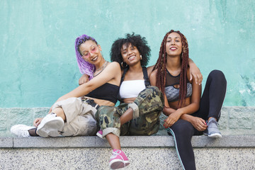 3 young black women laughing and having fun